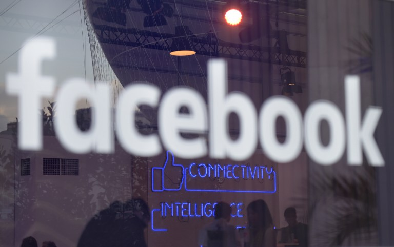 """The """"Facebook""""-logo is pictured on the sidelines of a press preview of the so-called """"Facebook Innovation Hub"""" in Berlin on February 24, 2016. / AFP / TOBIAS SCHWARZ"""
