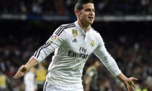 Real Madrid's Colombian midfielder James Rodriguez celebrates after scoring during the Spanish league football match Real Madrid CF vs Malaga FC at the Santiago Bernabeu stadium in Madrid on April 18, 2015.   AFP PHOTO/ GERARD JULIEN / AFP PHOTO / GERARD JULIEN