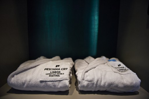 Bathrobes are displayed in the CR7 suite at the Pestana CR7 Lisbon Hotel during the official inauguration in Lisbon on October 2, 2016. / AFP PHOTO / PATRICIA DE MELO MOREIRA