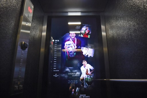 An elevator at the Pestana CR7 Lisbon Hotel shows a chronological display that goes through the highlights of Cristiano Ronaldo's career at the Pestana CR7 Lisbon Hotel during the official inauguration in Lisbon on October 2, 2016. / AFP PHOTO / PATRICIA DE MELO MOREIRA