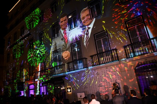 A picture of Real Madrid's forward Cristiano Ronaldo with the president of Pestana Hotels Group Dionisio Pestana is projected onto the facade of their hotel during the official inauguration of the Pestana CR7 Lisbon Hotel in Lisbon on October 2, 2016. / AFP PHOTO / PATRICIA DE MELO MOREIRA