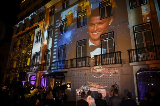 A picture of Real Madrid's forward Cristiano Ronaldo is projected onto the facade of their hotel during the official inauguration of the Pestana CR7 Lisbon Hotel in Lisbon on October 2, 2016. / AFP PHOTO / PATRICIA DE MELO MOREIRA