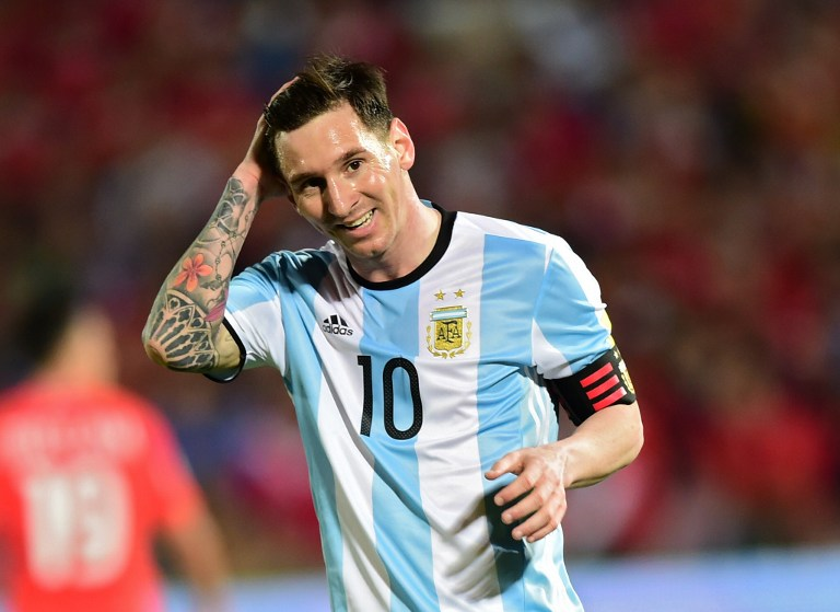 Argentina's Lionel Messi smiles during the Russia 2018 FIFA World Cup South American Qualifiers' football match against Chile, in Santiago on March 24, 2016.   AFP PHOTO / MARTIN BERNETTI / AFP / MARTIN BERNETTI